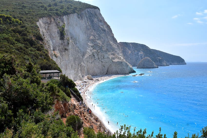 Lefkada: towering white cliffs over turquoise waters, trails through endless olive groves and refreshing waterfalls